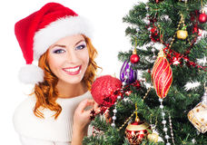 Portrait of a young woman posing near the Christmas tree Stock Image