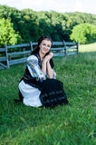 Portrait of young woman posing in Romanian traditional Stock Images