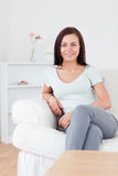 Portrait of a young woman posing on the sofa Stock Images