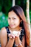 Portrait of a young woman with positive attitude smiling Stock Photography