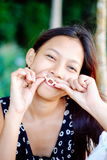 Portrait of a young woman with positive attitude smiling Stock Photos