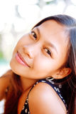 Portrait of a young woman with positive attitude smiling Stock Image