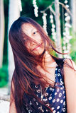 Portrait of a young woman with positive attitude smiling Royalty Free Stock Photos