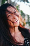 Portrait of a young woman with positive attitude smiling Royalty Free Stock Photo