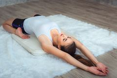 Portrait of young woman is practicing yoga in gym royalty free stock images