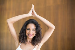 Portrait of young woman practicing yoga Stock Photos