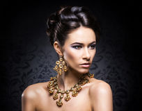 Portrait of a young woman in precious jewelry Stock Photography