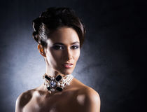 Portrait of a young woman in precious jewelry Royalty Free Stock Photo