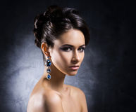 Portrait of a young woman in precious jewelry Royalty Free Stock Photography