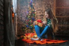 Portrait of a young woman during preparations for Christmas at home stock images