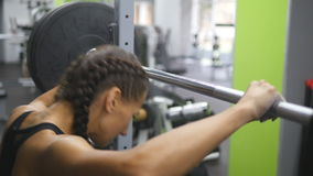 Portrait of young woman prepares to lift heavy barbells at the gym. Taped hands of girl clapping white chalk powder stock video