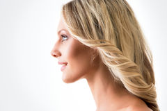 Portrait of young woman in profile Royalty Free Stock Image