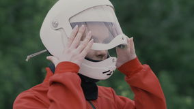 Portrait young woman in protective helmet slow motion. Girl in helmet on head stock video
