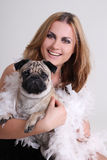 Portrait of young woman with pug dog Royalty Free Stock Images