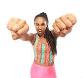 Portrait of a young woman punching with two hands Stock Images