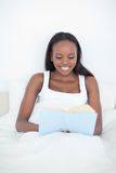 Portrait of a young woman reading a book Stock Images
