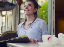 Portrait of young woman reading menu in the cafe Royalty Free Stock Photos