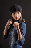 Portrait of young woman ready to fight. On a black background stock photo
