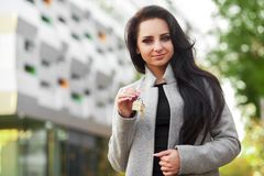 Portrait of a young woman realtor or businesswoman standing outd Stock Images