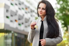 Portrait of a young woman realtor or businesswoman standing outd Stock Photography