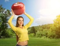 Portrait of young woman with red apple Stock Images
