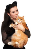 Portrait of young woman with a red cat Stock Photos