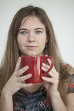 Young Woman with Beautiful Green Eyes with Red Coffee Cup Royalty Free Stock Images
