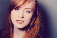 Portrait of young woman with red hair Stock Photo