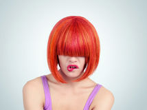 Portrait young woman with red hair and bang covering her eyes Royalty Free Stock Photo