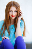 Portrait of a young woman with red hair Royalty Free Stock Images
