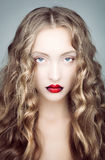 Portrait of a young woman with red lips. Royalty Free Stock Images