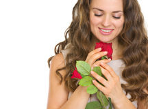 Portrait of young woman with red rose. Isolated on white Stock Photography