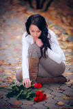 Portrait of young woman with red roses Royalty Free Stock Photo