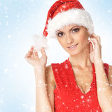 Portrait of a young woman in a red Santa hat Royalty Free Stock Photo