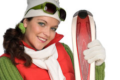 Portrait of young woman with red skis Stock Images