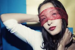 Portrait of a young woman in a red veil Stock Images
