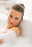 Portrait of young woman relaxing in bathtub Royalty Free Stock Image