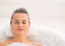 Portrait of young woman relaxing in bathtub Stock Images