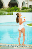 Portrait of young woman relaxing with cocktail Royalty Free Stock Images