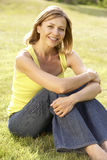 Portrait of young woman relaxing in countryside royalty free stock photo