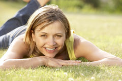 Portrait of young woman relaxing in countryside Stock Photo
