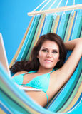 Portrait of young woman relaxing in hammock. With phone Stock Photo