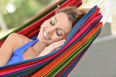 Portrait of young woman relaxing in hammock Royalty Free Stock Photos