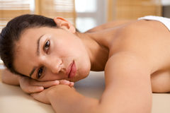 Portrait of young woman relaxing on massage table Royalty Free Stock Image