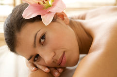Portrait of young woman relaxing on massage table Royalty Free Stock Photo