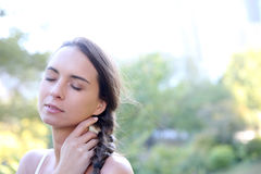 Portrait of young woman relaxing outdoors Stock Images