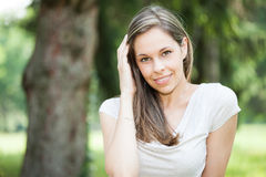 Portrait of a young woman relaxing outdoors Royalty Free Stock Image