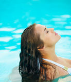 Portrait of young woman relaxing in pool Stock Images