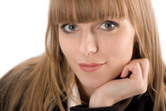 Portrait of young woman resting her chin on hand. Portrait of smiling young woman resting her chin on hand Royalty Free Stock Photography