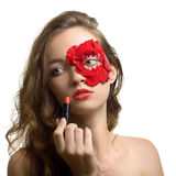 Portrait of young woman in rose petals Royalty Free Stock Photos
